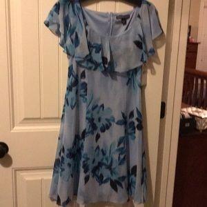 Blue flowered sheer dress with ruffled collar
